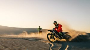 riding a dirt bike in sand